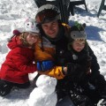 Dad and kids in the snow