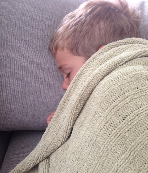 little-boy-sleeping-green-blanket